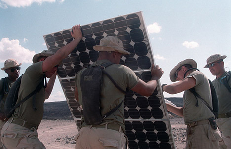 Marines from Marine Wing Support Squadron 371 (MWSS-371), Marine Corps Air Station, Yuma, Arizona, build a solar panel while performing humanitarian assistance operations in Djibouti, Africa.
