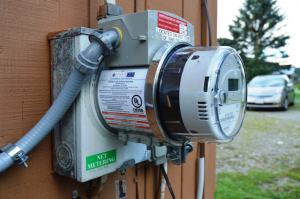 The ConnectDER device sits in-between the meter and the meter socket.. Photo credit: Department of Energy