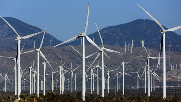 Wind turbines dot the landscape in Mojave, Calif. The recent extension of federal tax credits is expected to give the wind and solar energy industries a big boost. Irfan Khan/LA Times via Getty Images