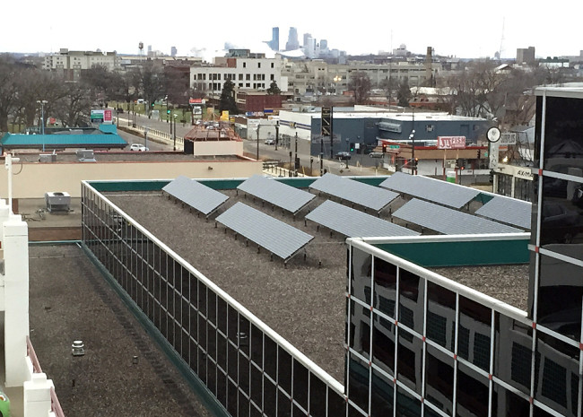 This 37-kilowatt solar array on the Spruce Tree Center at University and Snelling avenues in St. Paul was installed in 2010. Innovative Power Systems will install similar arrays on four more commercial buildings along the light rail corridor next year. Elizabeth Dunbar | MPR News