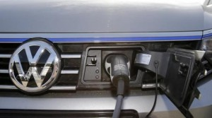 The charging plug of an electric Volkswagen Passat car is pictured at charging station at a VW dealer in Berlin