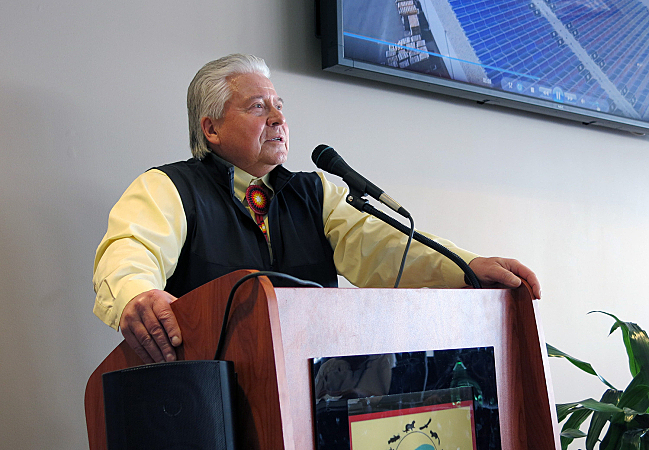 Red Lake development director Eugene McArthur announced plans Thursday to install acres of solar panels on the rooftops of the tribe's largest buildings. Construction of the project will begin this June and save the tribe roughly $2 million a year in energy costs. John Enger | MPR News