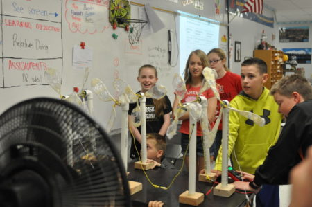 Beatrice Middle School six graders watch their handmade wind turbine models in action.
